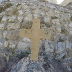 Cross in front of very old church