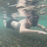Snorkeling barely above sea grass